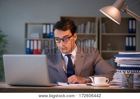 Businessman staying in the office for long hours