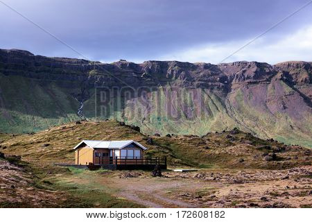 Small house in Iceland mountains, Europe.