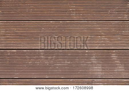 a brown wooden background with shabby paint