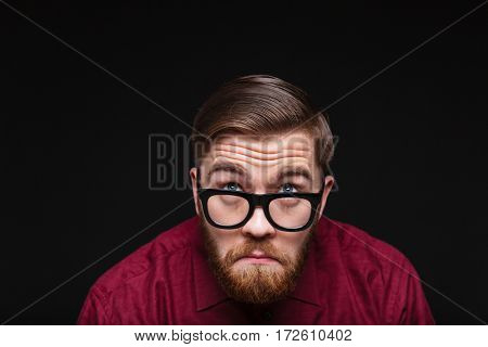 Surprised Male nerd looking behind the eyeglasses