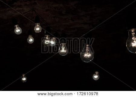 Several light bulbs glowing in the dark