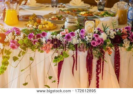 Beautiful flowers on table in wedding day services