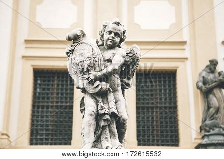 Statue of an angel next to the Church of the Nativity of the Lord (Loreto). Prague Loreta - a complex of historical buildings in Prague in Hradcany, Czech Republic. Europe.