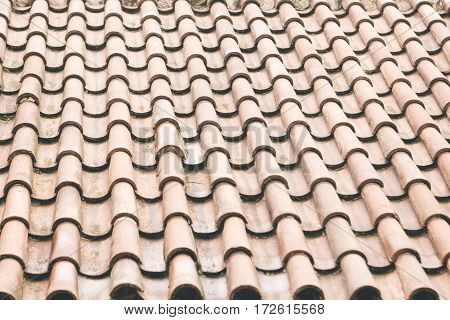 Structured clay tile roof background. The traditional view of the roofs in Eastern Europe.