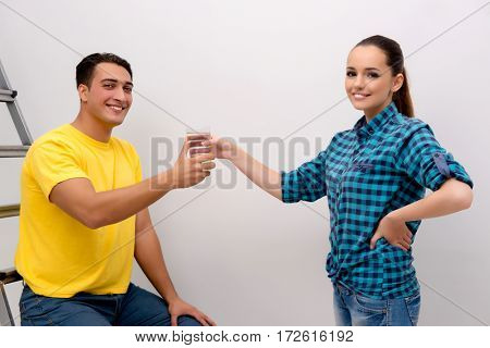 Wife and husband family doing home improvements