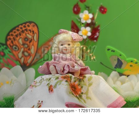 Thumbelina girl among the flowers and butterflies