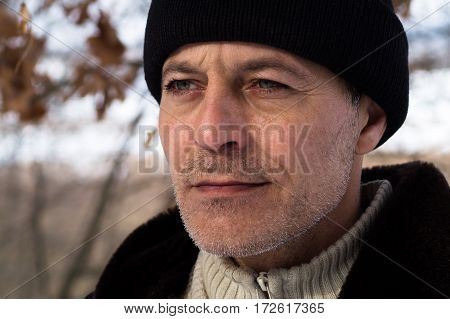 Portrait of a calm man in forest.