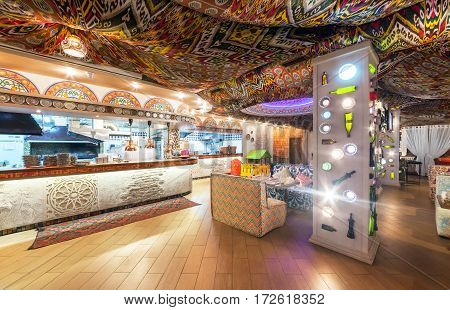 MOSCOW - AUGUST 2014: Interior Chaihana Lounge Eastern restaurant in a traditional style. The main dining room with an open kitchen with colorful fabric ceiling with ethnic patterns