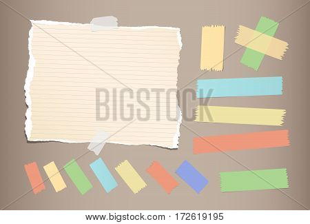 Ripped brown notebook, copybook, note paper, colorful sticky, adhesive masking tape strips stuck on brown background.