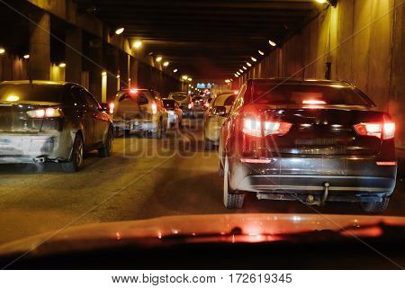 cars slowly crawling in a endless traffic jam