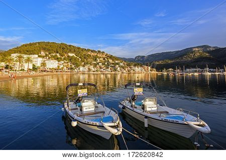 PORT DE SOLLER/  SPAIN - JUNE 12. Village Port de Soller viewed from the boat dock during sunset on June 12, 2016. Island Majorca, Spain.