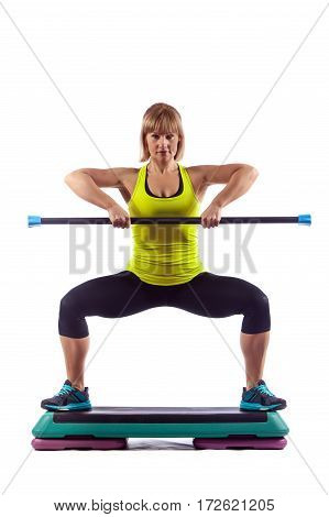 Fitness Woman Is Exercising With The Crossbar. Isolated On White Background.