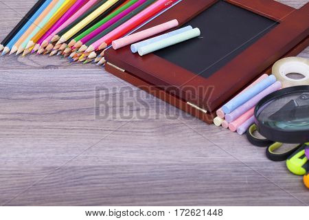 School Supplies on a dark background and place for text selective focus and small depth of field