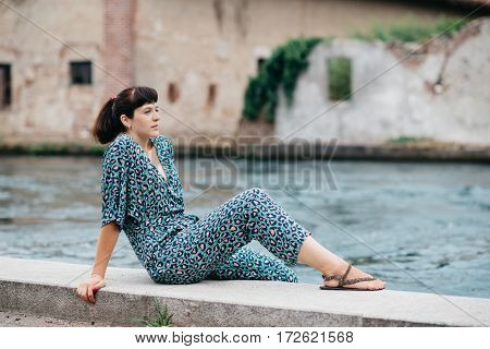 A Pretty Young Girl Spends Time On The Beautiful Banks Of The River