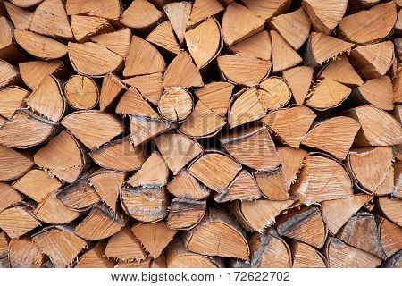 Texture background of brown wood logs in stack