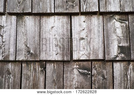 Texture background of roof wood tiles in Alps