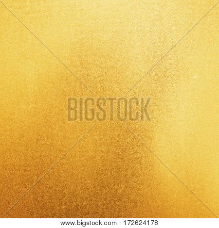 Scratched gold metal texture, yellow shiny background.