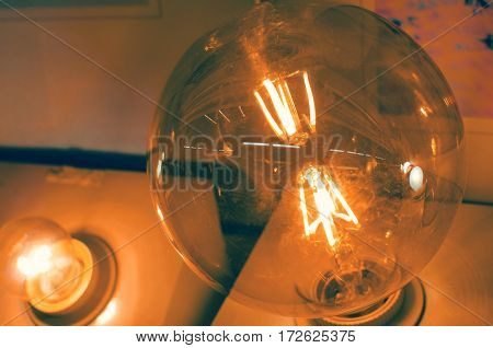 Big lightbulb producing electric light bulb yellow