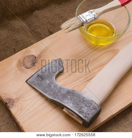 Upgrade axe. Paintwork handle axe flaxseed oil for water resistance. Upgrade axe. Scandinavian ax. tourist hatchet. Improving tourist ax. waterproofing handle axe.