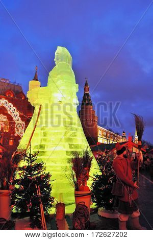 MOSCOW - FEBRUARY 18, 2017: Ice figure of a woman, Shrovetide decoration on Manezhnaya Square in Moscow city historic center. Color evening photo.