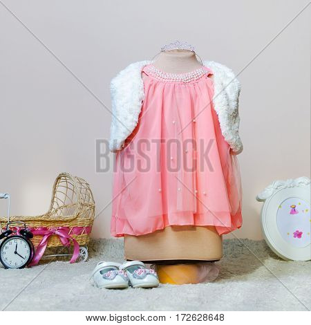 baby dress for a photo shoot on tailoring mannequin