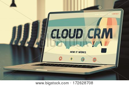 Modern Conference Room with Laptop on Foreground Showing Landing Page with Text Cloud Crm. Closeup View. Blurred. Toned Image. 3D.