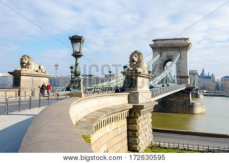 Budapest, Hungary - February 20, 2016: Magnificent Chain Bridge in beautiful Budapest. Szechenyi Lanchid is a suspension bridge that spans the River Danube between Buda and Pest in Budapest.
