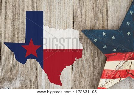 Map of Texas with the Texas Flag colors with a star on weathered wood background