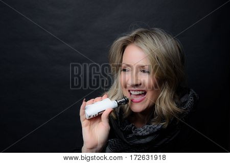 Low Key Image of A laughing Woman Vaping