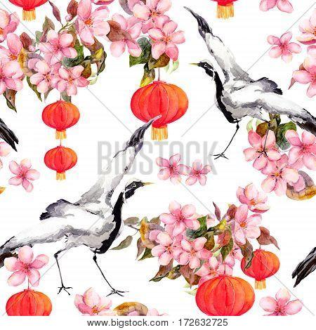 Red chinese lantern in spring pink flowers - apple, plum, cherry, sakura. Dancing crane birds. Seamless pattern. Watercolor