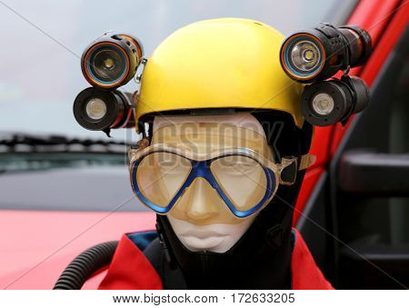 professional equipment for lighting during emergencies and caving expeditions with a dummy is a yellow protective helmet