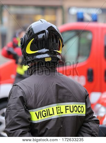 Firefighter With Protective Helmet And The Word Vigili Del Fuoco