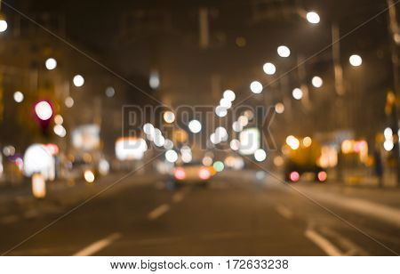 defocused colorful car lights and street lamp bokeh abstract background blurred city life at night