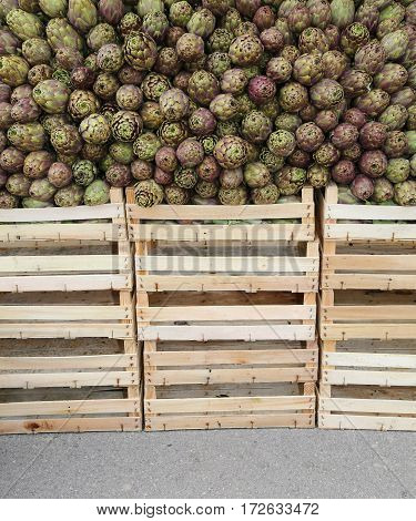 Green Artichokes And Boxes For Sale At The Grocery Store