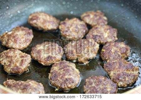 Meatballs fried in the pan with oil