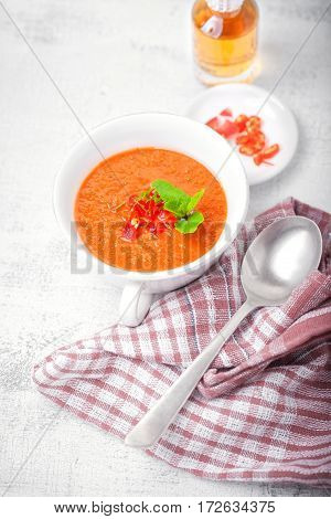 Bowl of fresh tomato soup gazpacho on the table