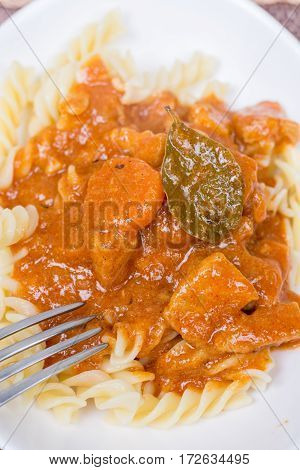 Served Pork Goulash With Macaroni On The Plate