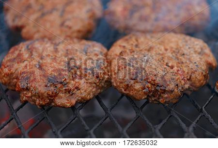 Beef or pork meat barbecue burgers for hamburger prepared grilled on bbq fire flame grill