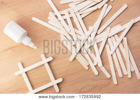 Kids school projects. Making things from wooden popsicle sticks (also called as wooden craft sticks)