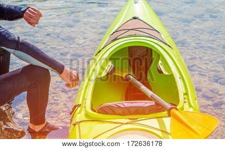 Kayaker and the Lake. Caucasian Kayaker Preparing For Lake Kayak Trip.