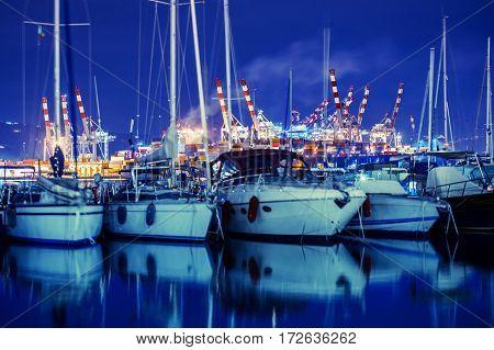 La Spezia Marina Yachts and Container Cargo Terminal in the Background. La Spezia Liguria Italy. Night Time Photo.