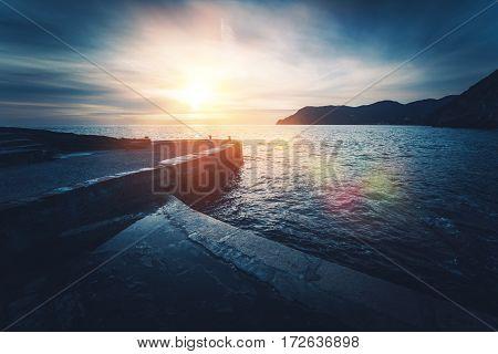 Mediterranean Sea Sunset. Vernazza in Province of La Spezia Italy. Dark Blue Color Grading.