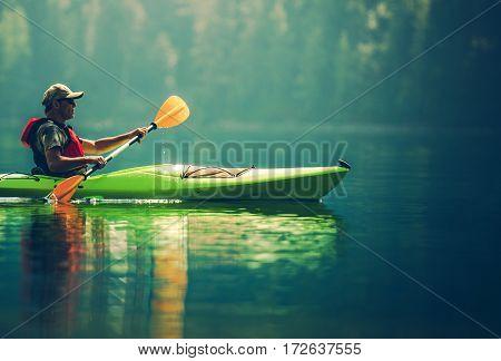 Senior Kayaker on the Lake. Kayak Paddling. Water Sport and Recreation.