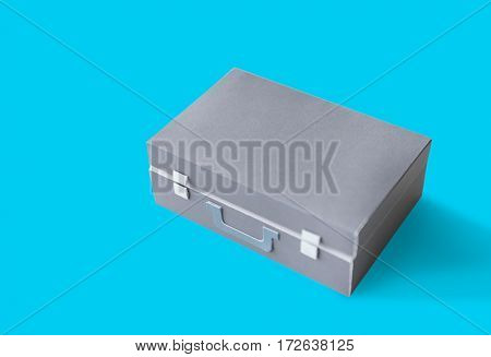 Closed Suitcase in Grey with Green Handle Isolated