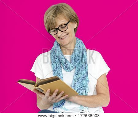 Mature Caucasian Woman Smiling Holding Notebook