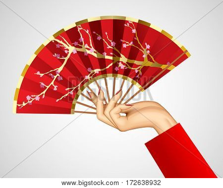 Woman's hand with open chinese red fan isolated on white. Contains the Clipping Path