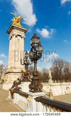 Bronze lamps on Alexander III Bridge Paris France.