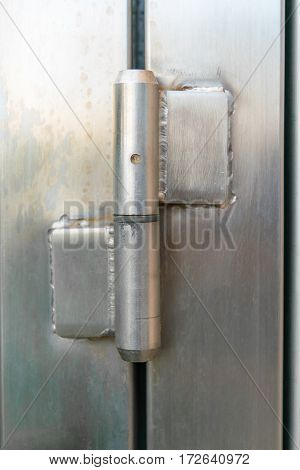 Steel hinge. Industrial element made of metal. Closeup.