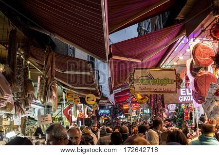 ISTANBUL TURKEY - DECEMBER 29 2015: Picture of Hasircilar Street at rush hour heavily crowded near the Egyptian bazaar aka Spice Market