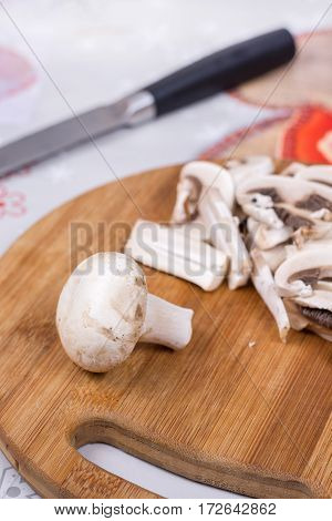 Sliced And Chopped Mushrooms On The Cutting Board